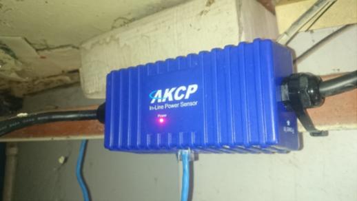 AKCP In-Line Power Meter installed under the floor below the ATM.