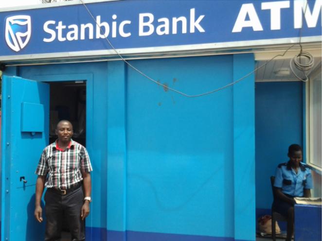 Stanbic Bank off-site ATM kiosk with Mugenyi Moses, AKCP dealer for Uganda.